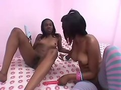 Blonde black lesbian licking pussy on bed
